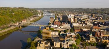 Long Panoramic View Charleston West Virginia Capitol City. Sunrise reflects in the Kanawha River slowly flowing by picturesque Charleston West Virginia downtown stock photo