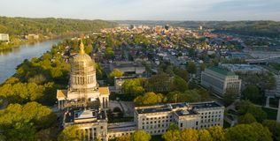 Long Panoramic View Charleston West Virginia Capitol City. Sunrise reflects in the Kanawha River slowly flowing by picturesque Charleston West Virginia downtown stock photography