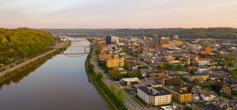 Long Panoramic View Charleston West Virginia Capitol City. Sunrise reflects in the Kanawha River slowly flowing by picturesque Charleston West Virginia downtown royalty free stock images
