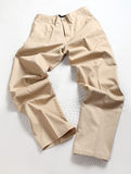 Long Pants. A pair of beige color long pants royalty free stock images