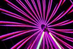 Long parc d'attractions d'exposition de nuit Image stock
