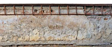 Long part of the destroyed aged  centenary temple and church yel. Low plastered  wall and fence.  Isolated  on top panoramic collage from several photos Royalty Free Stock Images