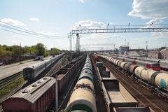 Long passenger and freight trains at railway Royalty Free Stock Photography