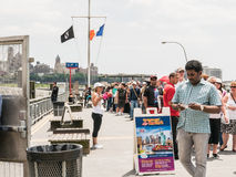 Long passenger line at City Sightseeing of New York, on Pier 11 Royalty Free Stock Images