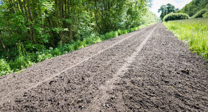 Long Path Of Loose Earth With A Tire Track Stock Photo