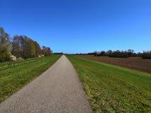 long pathway over a dyke stock photos