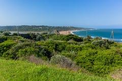Long paysage de plage d'océan de rivière de pont photos stock