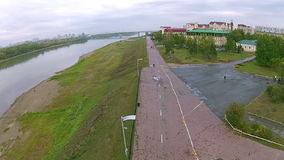 A long pedestrian street along the river. Quadrocopters removes the pedestrian street along the river in the provincial town stock video footage