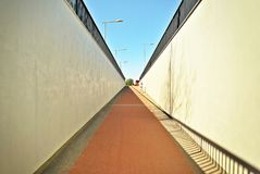 A long pedestrian tunnel Stock Images