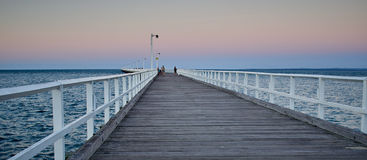 Long pier with angle in the middle. Royalty Free Stock Photography