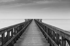 The long pier. A pier on the beach of Lomma in the south of Sweden Royalty Free Stock Photography