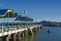 Long pier for boats and tourist ships Ha long bay in Vietnam Stock Image