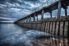 Long Pier at the Coast Royalty Free Stock Photography