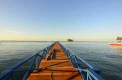 Long pier dan beautiful coral at Mabul Island Stock Image
