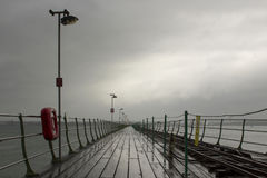 The long pier at Hythe in the south of England with its wooden walkway and railway line to the Southampton Ferry that leaves from Stock Images