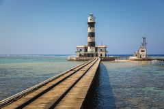 Long pier with lighthouse at the end. Angle shot stock photography