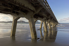 Long pier in Tolaga Bay in New Zealand. Pier in Tolaga Bay in New Zealand Royalty Free Stock Images