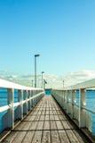 Long pier towards the ocean Royalty Free Stock Photos