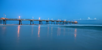 Long pier during twilight Stock Images