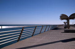 Long pier. View of the long pier and sealine in Alicante, Spain royalty free stock photo