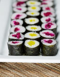 Long Plate filled with Pickled Hand Rolled Sushi Stock Photos