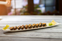 Long plate with sushi rolls. Stock Images