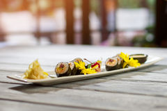 Long plate with sushi rolls. Royalty Free Stock Photos