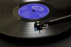A Long play vinyl record on a turntable with tone arm and cartridge in Bangor County down in Northern Ireland. A Long play vintage vinyl record on a turntable stock image