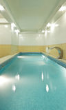 The long pool in sauna. Beautiful emerald water in bath for resting and swimming Royalty Free Stock Images