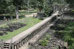 Long porch in Angkor. Long porch with columns in ancient Angkor Royalty Free Stock Photography