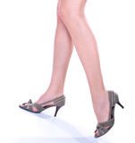 Long pretty woman legs on hills Royalty Free Stock Photo