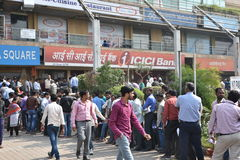 Long queue of people outside banks to deposit old 500 and 1000 currency notes and get new currency. EDITORIAL: NOV 12th, 2016: Gurgaon, Delhi, India: Long queue Royalty Free Stock Images