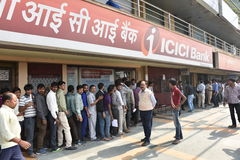 Long queue of people outside banks to deposit old 500 and 1000 currency notes and get new currency. EDITORIAL: NOV 12th, 2016: Gurgaon, Delhi, India: Long queue Stock Photos