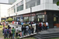 Long queue of people outside banks to deposit old 500 and 1000 currency notes and get new currency. EDITORIAL: NOV 12th, 2016: Gurgaon, Delhi, India: Long queue Royalty Free Stock Photo