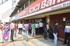 Long queue of people outside banks to deposit old 500 and 1000 currency notes and get new currency. EDITORIAL: NOV 12th, 2016: Gurgaon, Delhi, India: Long queue Stock Photo