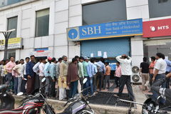Long queue of people outside banks to deposit old 500 and 1000 currency notes and get new currency. EDITORIAL: NOV 12th, 2016: Gurgaon, Delhi, India: Long queue Royalty Free Stock Image