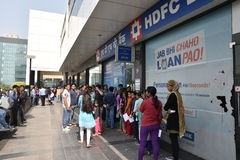Long queue of people outside banks to deposit old 500 and 1000 currency notes and get new currency. EDITORIAL: NOV 12th, 2016: Gurgaon, Delhi, India: Long queue Royalty Free Stock Photography