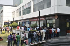 Long queue of people outside banks to deposit old 500 and 1000 currency notes and get new currency Royalty Free Stock Photo