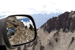 Long queue of vehicle seen through the front mirror, road block near Khardung La (pass), Ladakh Stock Photos