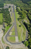 Long Race Track. Aerial perspective of race track on sunny day Stock Photos