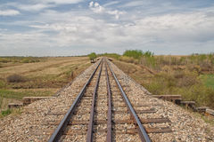 Long railway track countryside Royalty Free Stock Images