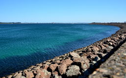 Long rampart  in Yarra Bay. Long rampart separates the industrial area from the sea in Yarra Bay Stock Photos