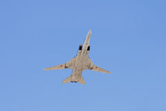 Long-range strategic bomber. Tu-22, long-range strategic bomber over blue sky (Blinder Stock Photo