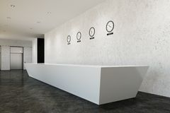 Long reception desk, clocks, side, concrete. Long white reception counter standing in an office with concrete walls and a gray floor and a row of clocks showing Royalty Free Stock Image