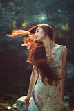 Long red blowing hair Stock Photography