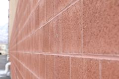 Long Red Brick Wall construction stock photography