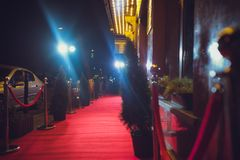 Long red carpet between rope barriers on entrance. Red Carpet Fashion Awards is a celebrity fashion website which chronicles the ensembles from runways and red stock photography
