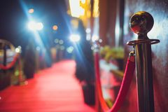 Long red carpet between rope barriers on entrance. Red Carpet Fashion Awards is a celebrity fashion website which chronicles the ensembles from runways and red stock photos