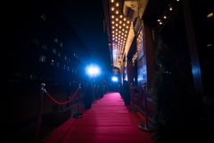 Long red carpet between rope barriers on entrance. Red Carpet Fashion Awards is a celebrity fashion website which chronicles the ensembles from runways and red royalty free stock photos