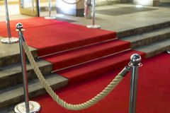 Red carpet. Long red carpet between rope barriers on VIP entrance royalty free stock photo
